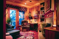 Study. Cozy room with recovered Pecky Cypress cabinets, paneling and ceiling