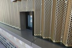 An IMAR cladding of corrugated perforated aluminium with an anodized gold finish crowns the renovation work of an old warehouse in the modern district of Whitec. Metal Cladding, Metal Facade, Metal Panels, Cladding Ideas, Parking Building, London Architecture, Perforated Metal, Corrugated Metal, Refurbishment
