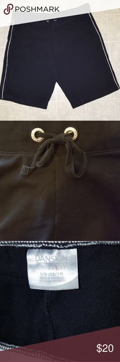 Danskin black shorts/white piping, Size 12/14 Danskin long black shorts with white piping on the sides. Very wide waistband. Worn once, like new. Ties in front. Size 12/14. 95% cotton, 5% spandex. Just in time for summer sports! Smoke free home. Fast shipping! Danskin Shorts Bermudas