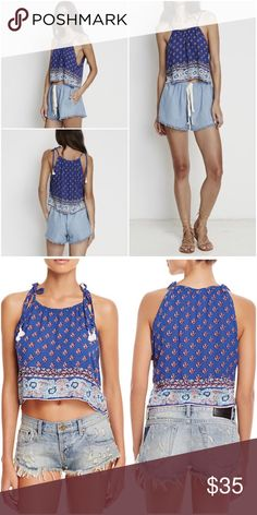 Faithfull Tiki Cami Crop Top Romantic Floral New A bandanna print in blue and red is even better for summer when trimmed by a tiki floral design, both hand-printed in Bali on this Faithfull the Brand top. Tasseled tie straps and a cropped hem make the silhouette airy, effortless and oh-so alluring.  Designed for a relaxed fit Self-tie tassel spaghetti straps, round neck Sleeveless, cropped hem, pullover style  This garment has been printed and dyed by hand for a unique, one-of-a-kind finish…