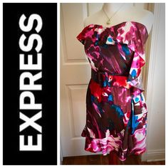 ✨ Express Belted Watercolor Side Ruffle Dress Stunning dress by EXPRESS. Watercolor design, side ruffle with wide belt (loops intact). Back zipper and hook and eye closure. This dress is such an eye catching piece, absolutely beautiful and in perfect condition! Shell, 93% Silk, 7% Spandex; Lining, 96% Polyester, 4% Spandex. No trades or PayPal, ✅Bundles. Express Dresses