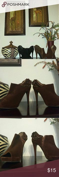 """Ruffled Peep Toe Booties Size 7 1/2 Very Cute stilettos with layered ruffles! Used in good condition. Some scuffing as pictured.   Size 7 1/2, Velvet like Material, Zipper Detail on Ruffles, Heel Height 4"""", Peep Toe, Zip Closure at Side. Shoes Heeled Boots"""