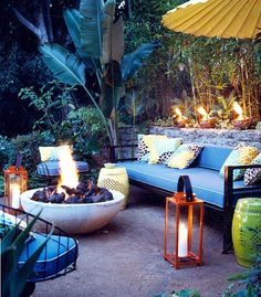 Judy Kameon, Elysian Landscapes, outdoor seating area with fire and lanterns, red Casimidy lanterns