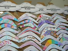 Paper boomerangs colored by local elementary school classes. The boomerangs were used in an effort to represent Australian culture.