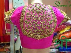 Fuchsia pink color pure silk designer blouse with short sleeves and high neck patterned. embroidered thread work floral design embellishe...
