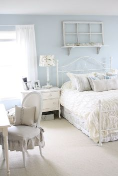 Cool & airy cottage style room created with pale blue walls and white furniture :)