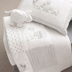 white baby quilts   Baby Elephant bedding from The White Company: