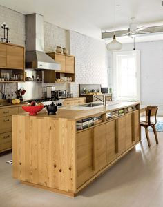 Island and cabinets fashioned from remilled Douglas-fir beams salvaged from upstate New York.
