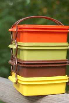 Tupperware. I had the brown lunchbox for kindergarten and I hated it!! I thought it looked like chocolate pudding - which I never got :( so deprived lol.