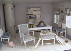 Drawing room of the Scandinavian style dollhouse....see the tile stove