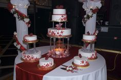 Red quinceanera cake and decor