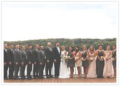 mismatched gray groomsmans' suits and pink & gray bridesmaids' dresses