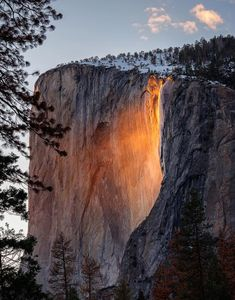 Every February a rare phenomenon makes Horsetail Fall @Yosemitenps glow like fire. Pic from Saturday by Ray Lee #California #firefall - A waterfall glows orange down the side of a granite formation