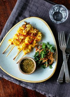 Squid anticuchos - Peruvian cuisine: Anticuchos are meat skewers eaten as a starter or snack in Peru. Peruvian restaurant Pachamama uses squid marinated in turmeric for a contemporary twist. A stylish dinner party starter.