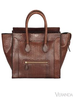 Céline Tote Bag  Céline's python mini luggage bag is the tote she's been searching for: practical, roomy, classic—even an outside pocket. $4,500. 305-866-1888;