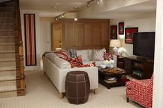 Sarah Richardson Design - Basement family room with ivory walls paint color, Ikea Karlstad sectional.