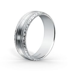 Comfort fit 7 mm gentlemen's wedding band from the Artin collection. The signature handcrafted details include wheat hand engravings, satin finish and milgrain edging. Also available in multiple widths.