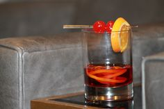 Hunt Club Old Fashioned - bourbon, bitters, sugar and a twist of citrus then garnished with an orange slice and cherries