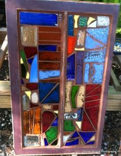 JUNK MARKET Style stained glass windows. would be good for the shed.