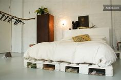Gorgeous rustic chic bed on crates in a factory apartment in Kreuzberg.