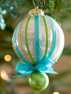 A beribboned ornament with an extension.