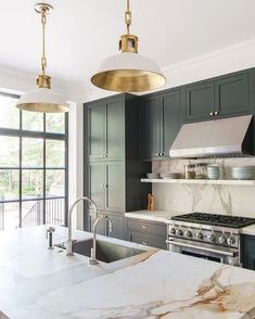 The marble backsplash is cleverly used again on the countertop, tying the two parts together. Great lights above the island.