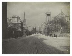 Holy Corner at the junction of Morningside Road with Colinton Road. There are four churches on the road at this point Description Tram tracks run down the street towards Holy Corner at Morningside, Edinburgh. The spire of Christ Church Episcopal Church can be seen on the left and the tower of North Morningside Church on the right. Many people are walking along the pavements. By  Francis M. Chrystal, 1912