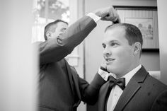 candid groom getting ready in home wedding photography san diego