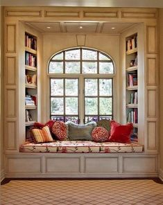 Window seat with bookshelves. I would love to have this in my house. I have a weakness for window seats.