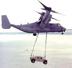V-22 Osprey carrying a Humvee