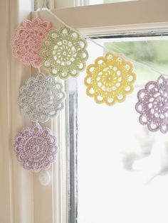 a simple bunting of crochet doilies in pastel shades Crochet Bunting, Crochet Garland, Crochet Curtains, Crochet Decoration, Crochet Motifs, Crochet Doilies, Crochet Flowers, Crochet Patterns, Crocheted Lace
