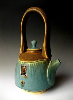 Nick DeVries     Teapot with Feather Carving.