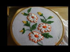 This video channel contains lot of Hand Embroidery work designs & paper craft designs.Today we know the simple & easiest hand Embroidery work is Satin stitch Design.I used satin stitch for flowers, long & short stitch for middle of the flower, Stem s