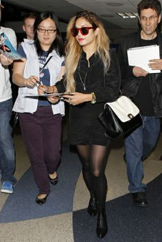 Vanessa Hudgens shows off her freshly dyed blonde locks at LAX airport.