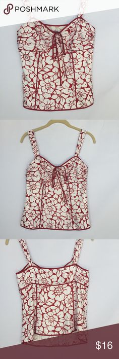 "Ann Taylor red and white floral cropped tank top Gently used Ann Taylor red and white floral cropped tank top size 2. No stains or holes. Is lined and has a zipper on the side. Length 21-23"" Ann Taylor Tops Crop Tops"