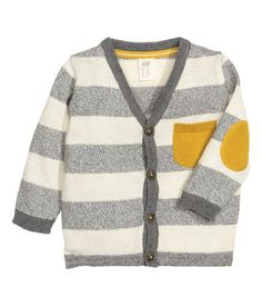Fine-knit cardigan in soft cotton with a V-neck, buttons at front, and contrasting chest pocket and elbow patches.