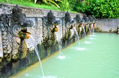 The sacred hot springs Air Panas Banjar in Indonesia are surrounded by lush tropical gardens and are enjoyed by all. Book a flight to Bali to discover the magic and fully unwind.