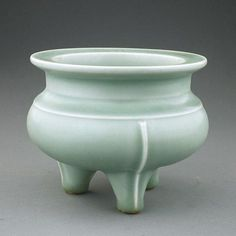 ANTIQUE CHINESE SONG STYLE CELADON TRIPOD CENSER Of compressed globular form, stamped with mark in interior. D: 5 1/8 in. x H: 4 1/4 in.