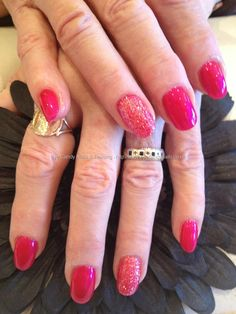 Cuccio hot pink polish with pink glitter over acrylic nails