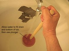 How to Unclog a Tub Drain: Fill Drain and Bottom of Tub with Water and Use Plunger