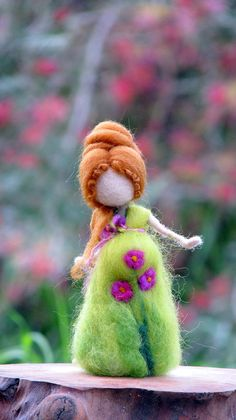 Needle felted Waldorf inspired standing doll. She is tall about 5, her dress made out of soft merino and silk. Decorated with flowers. Ready to ship now. Thank you for visiting my shop!! Please see my shop policies for more information: http://www.etsy.com/shop/Made4ubymagic/policy