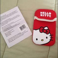 Hello kitty Red never used Nintendo DS game holder Hello Kitty Nintendo DS game holder never used.. It can also serve as a cell phone holder Hello Kitty Accessories