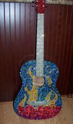 Do I have to describe it?  It's a guitar.  With decoration.