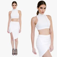 WHITE ASYMMETRICAL SKIRT Bring new life to a new look, in our White Asymmetrical Wrap Skirt featuring a diagonal slant down the leg just above the knee, fold-over wrap with a crossed front, skew hem and invisible zipper closure. This skirt pairs perfect with an open toe black heels and a statement necklace. Pictures are showing a small   White Asymmetrical  Foldover Mini-Skirt 95% Polyester 5% Spandex Style Link Miami  Skirts Asymmetrical