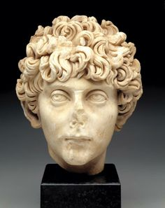 Head of a Roman Youth. AD 140-170. Roman Imperial. This strikingly handsome and sensitive portrait head in the plastic Hadrianic-Antonine style of the mid-2nd century A.D. is similar to a portrait of the young Marcus Aurelius in the Capitoline Museum, Rome. It may represent a prince of the imperial family, one of the children of Antoninus Pius. Source: Dallas Museum of Art