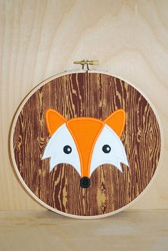 Love this fox portrait on a faux bois embroidery hoop background!