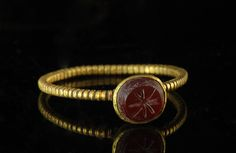 Roman gold ring with Carnelian stone. c. 2nd Century AD. Wow.