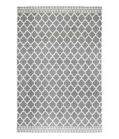 Gray. Rectangular rug in cotton fabric with a printed pattern at front.