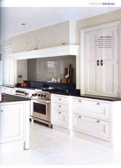 Bespoke open plan Martin Moore kitchen featuring a wooden breakfast ...