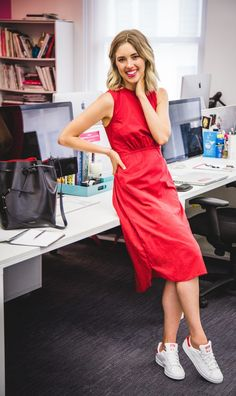 Our editor wears sneakers to the office with a fiery red dress and a Mansur Gavriel bucket bag.